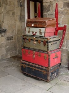 7439116-old-suitcases-stacked-on-a-trolley