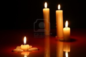 15835631-few-lighting-candles-on-dark-background-with-reflection